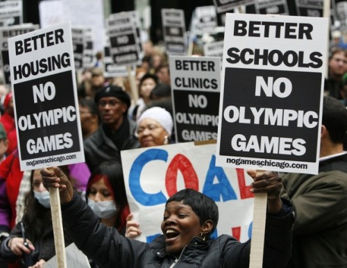 Protesters cheer at an anti-Olympics bid rally in Chicago